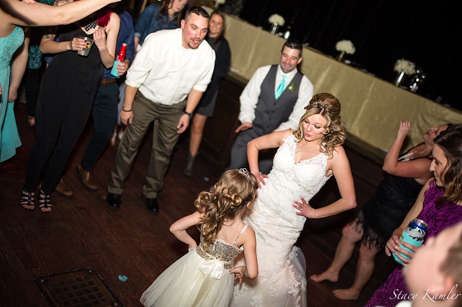 Bride and Flower Girl Dancing