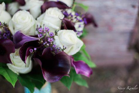 Purple flowers in brides bouquet