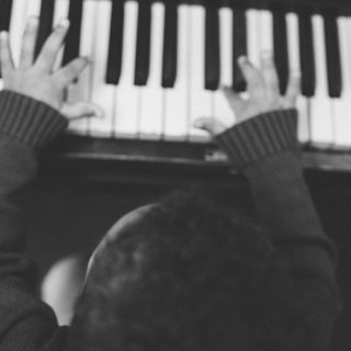2 year old playing the piano