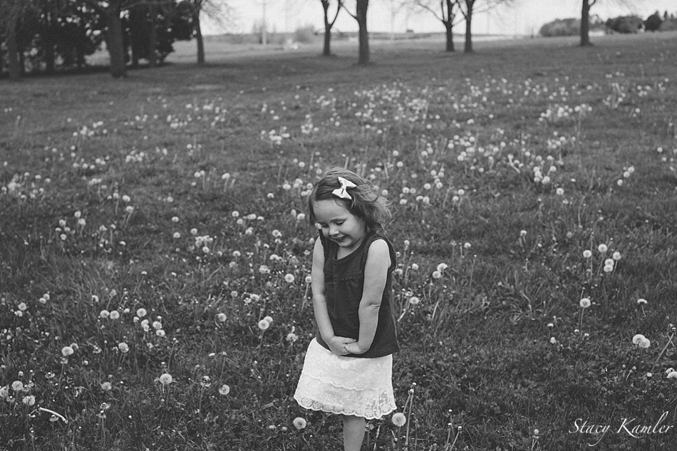 3 year old running in a field of dandelions