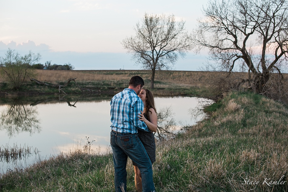 Couple by family pond for engagement session