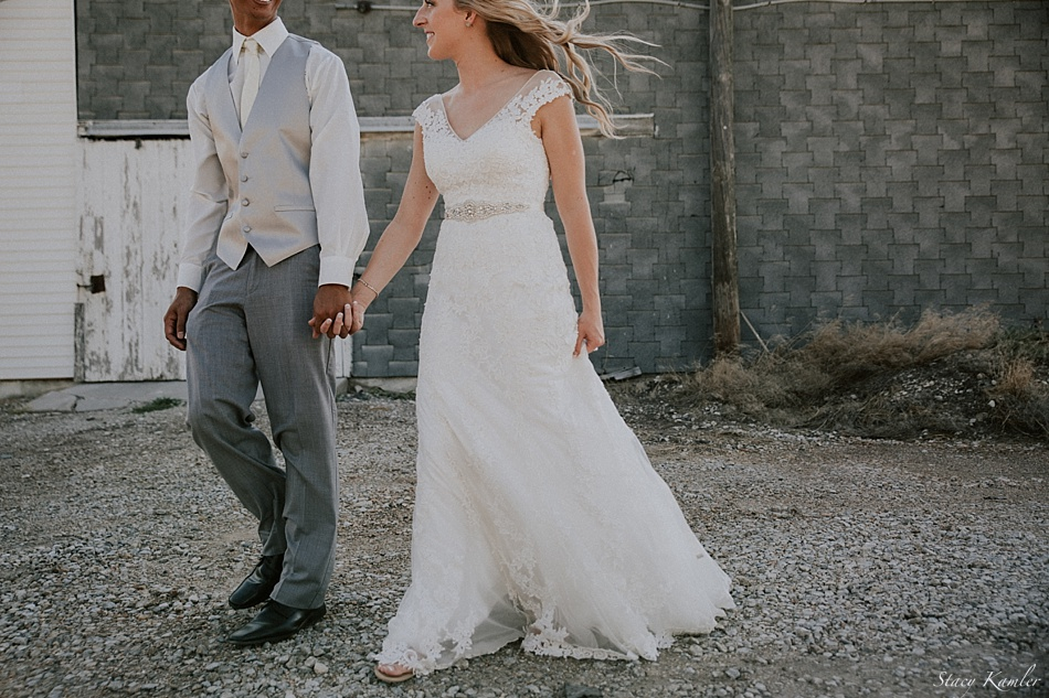 Antique lace wedding dress and grey tux