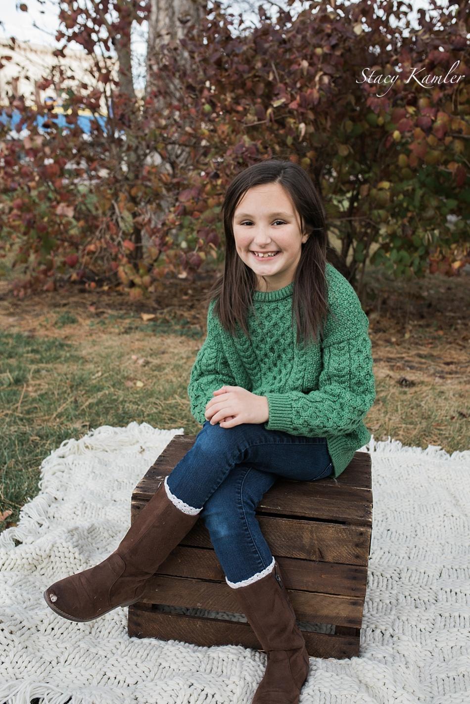 Girl portraits in green sweatshirt for fall
