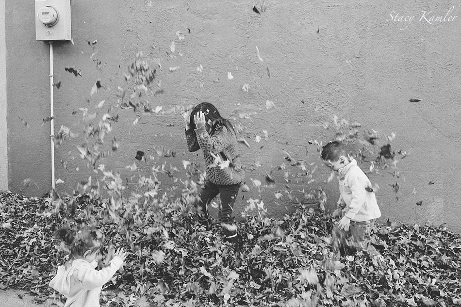 Throwing fall leaves for family photos in Geneva, NE