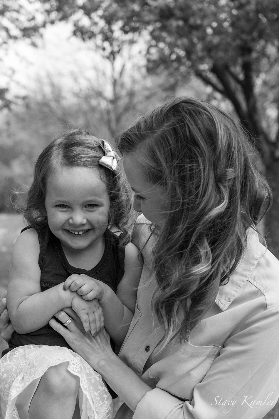 Mother and Daughter laughter during family photos