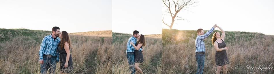 Dancing in the sunlight and tall grass for engagement photos in Geneva Ne