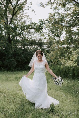 Bride dancing in the meadows