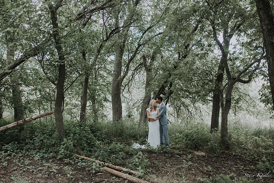 Bride and Groom in green grass and wooded area for portraits