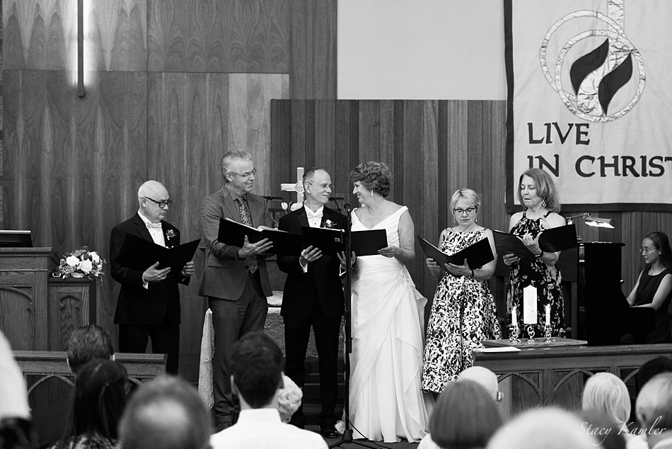 Bride and Groom singing at their ceremony in Central City, NE