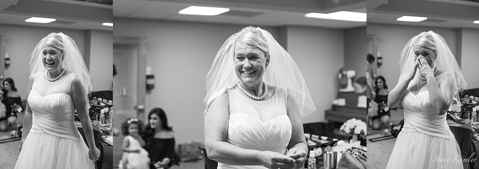 Bride seeing herself for the first time in Wedding Dress