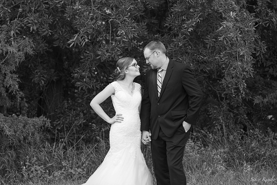 Black and White Bride and Groom Portraits in front of Trees