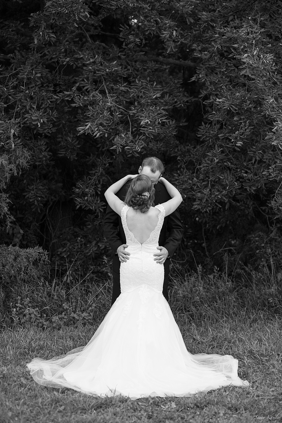 Bride and Groom. Two Strapped lace low back wedding dress