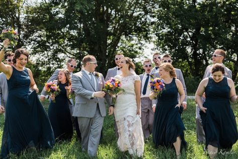 Bridal Party Photos in Roca, Ne with Navy Blue Dresses and Grey Suits