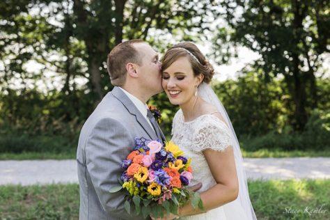 Bride and Groom Portraits in Roca, Nebraska with Summer bouquet