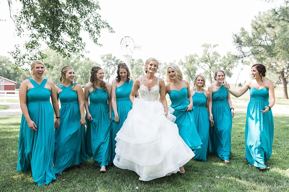 Bridesmaids wearing teal dresses