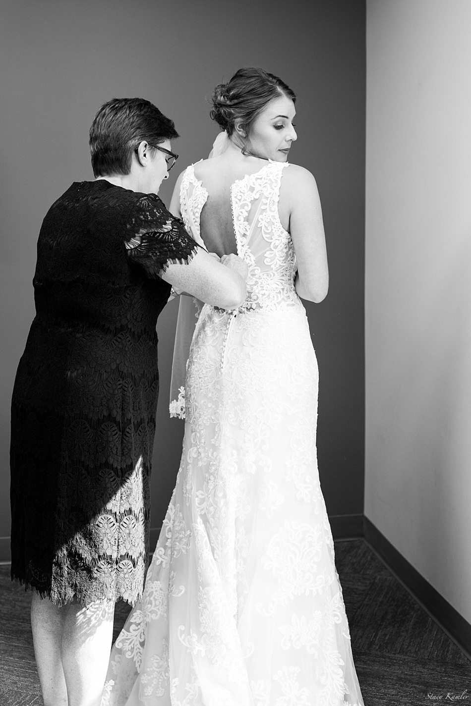 Bride Getting Dressed in a lace Dress