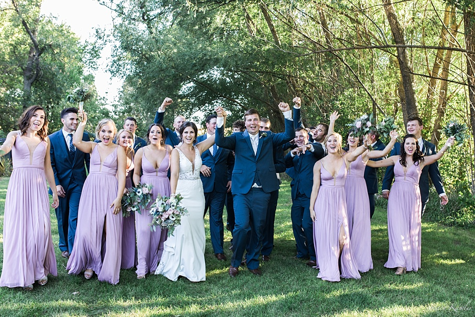 Bridal Party with blue tuxes and purple dresses