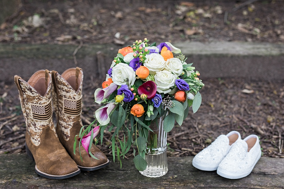 Grooms boots and Brides shoes and bouquet