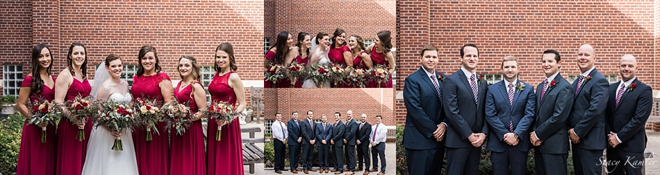 Bridal party with navy blue tuxes and red dresses
