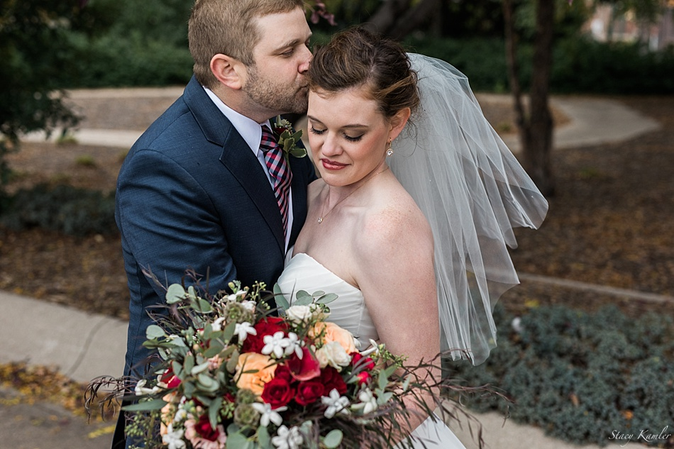 Bride and Groom with red bouquet