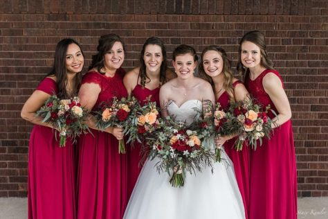 Bridesmaids with red dresses