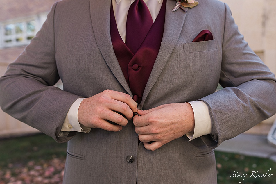 Groom in grey suit and maroon tie