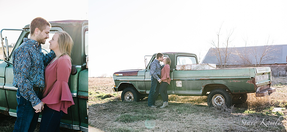 Old green truck with couple
