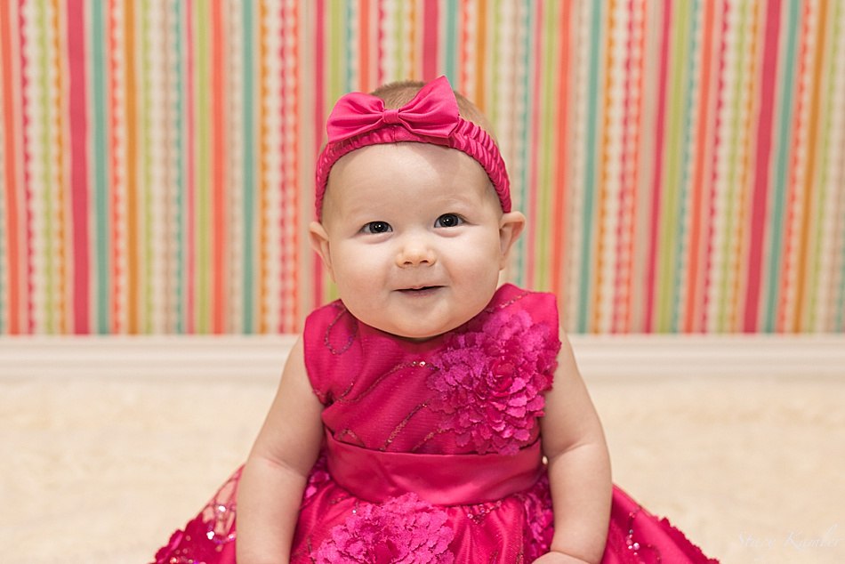 6 month girl in pink dress and bow
