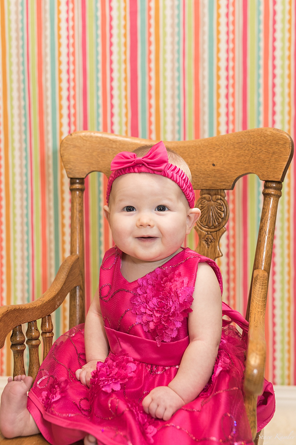 6 month girl in wooden chair
