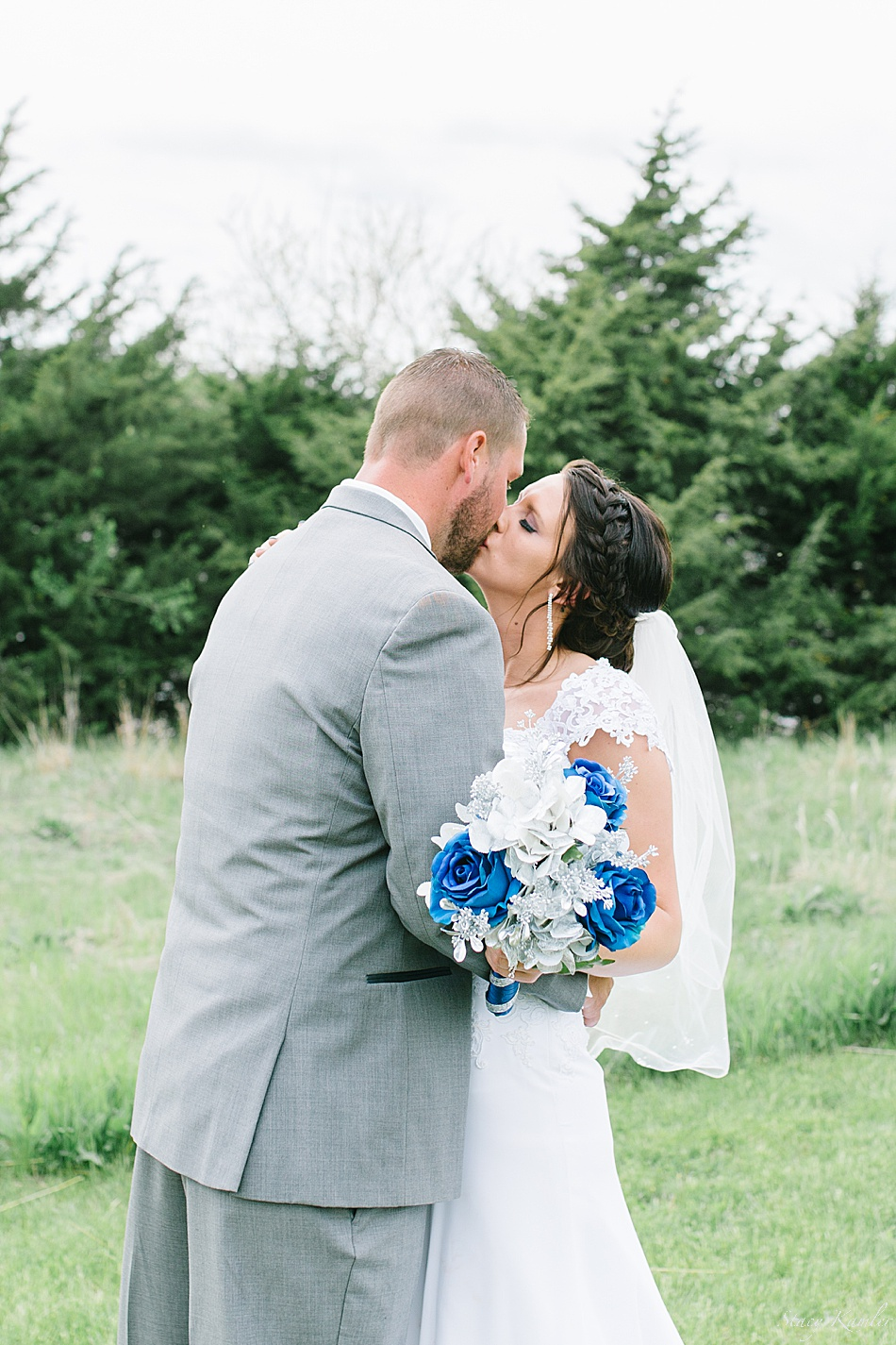 Bride and Groom with Blue bouquet, kissing
