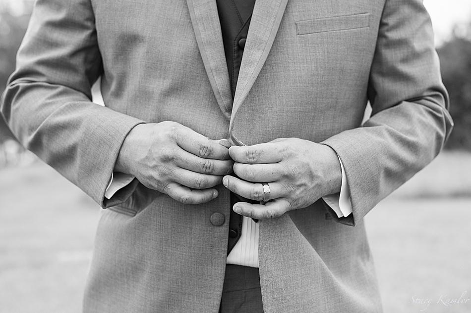 Groom buttoning jacket