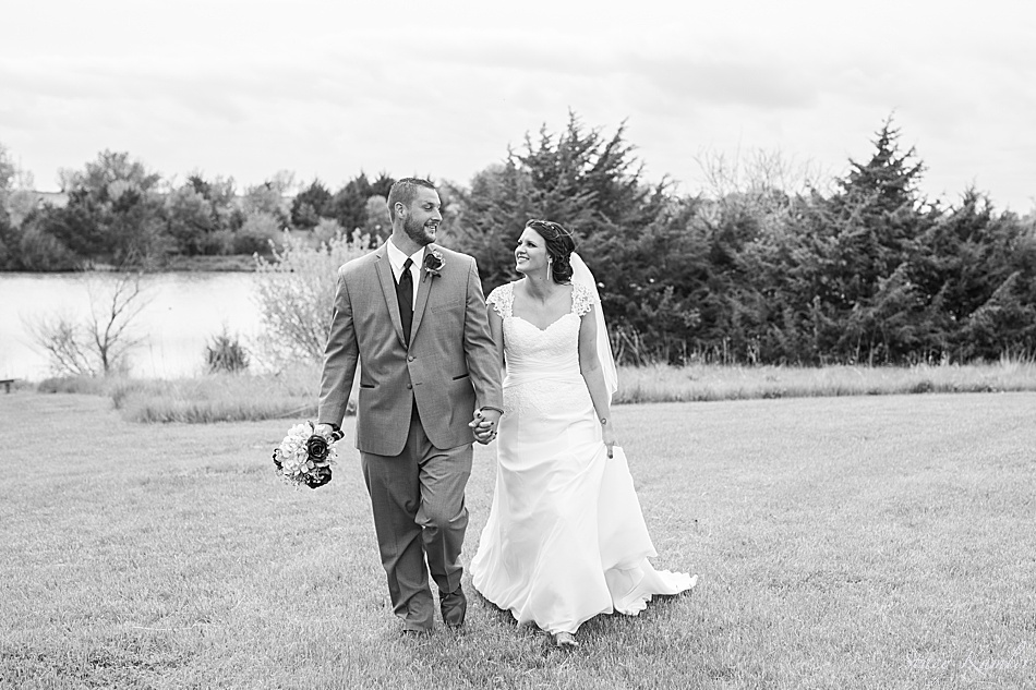 Bride and Groom walking at Recharge lake