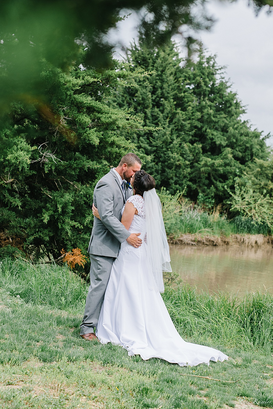 Bride and Groom kissing at Recharge Lake, York, NE