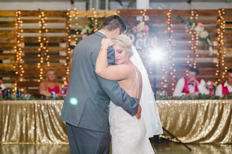 Bride and Groom cuddling with first dance