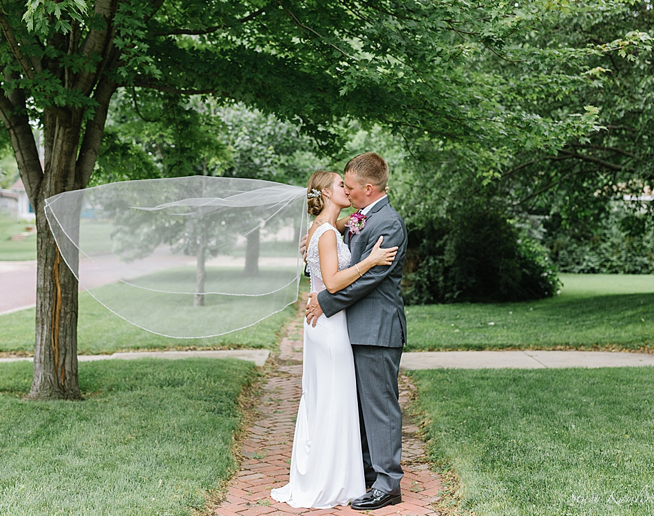 Couple's Wedding photo with the wind in the veil