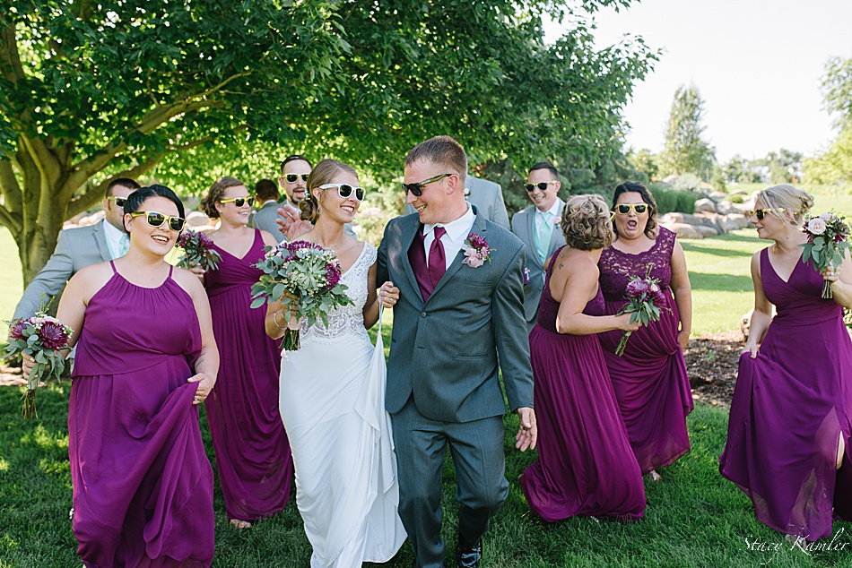 Grey Tuxes and Sangria dresses for the bridal Party