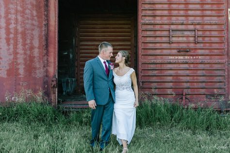 Bride and Groom Portraits in from of a red train car