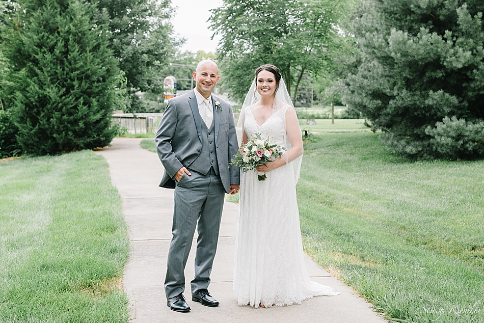 Bride and Groom walking on path outside