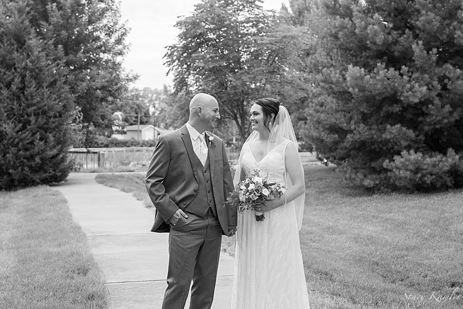 Bride and Groom walking on path outside in Geneva, NE