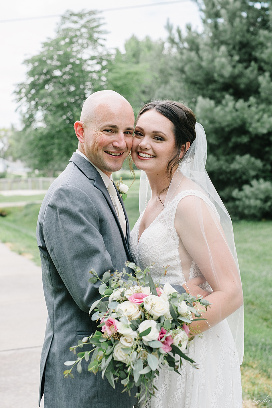 Groom in Grey tux and bride in white tank dress