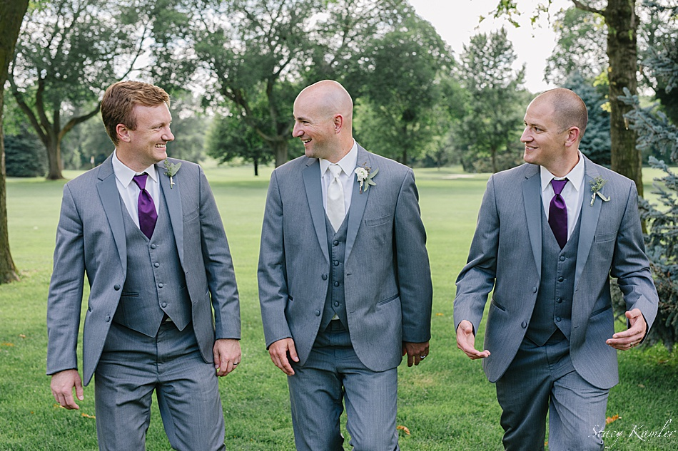 Groomsmen laughing during their portraits