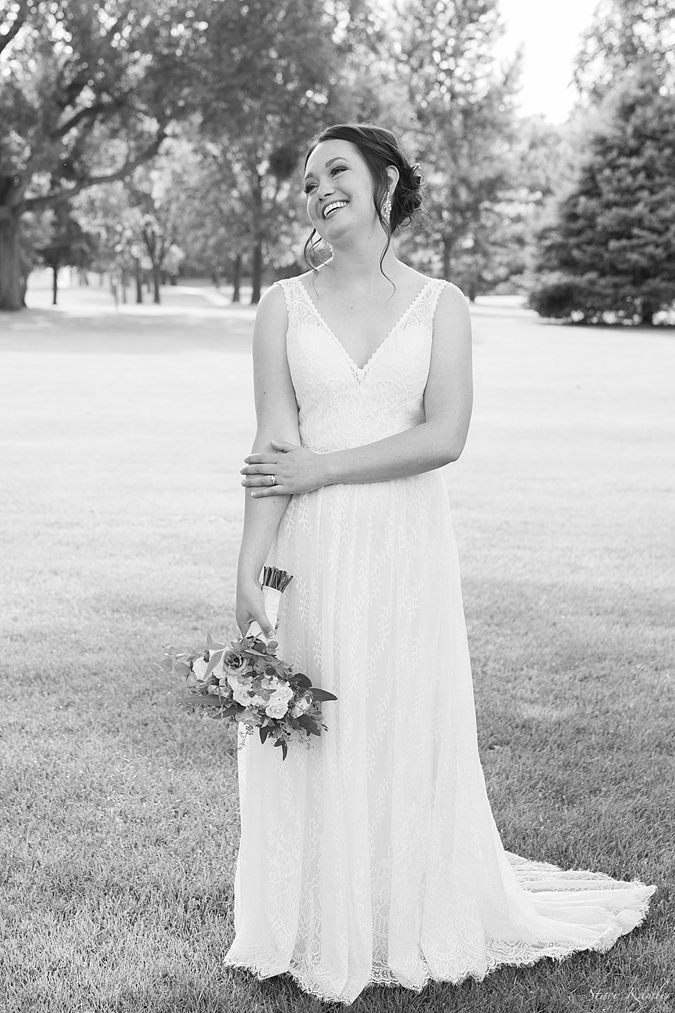 Bride laughing at the Groom