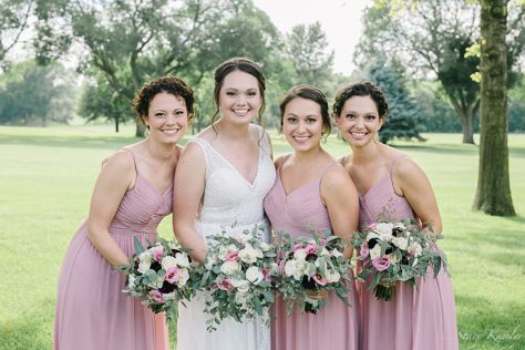 Bridesmaids in dusty pink dresses at the York Country Club