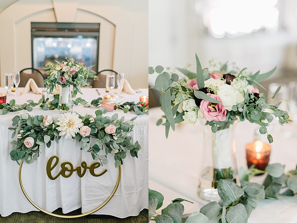 Flowers at the head table with golden LOVE ring