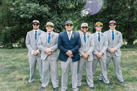 Groomsmen in favorite sports team hats