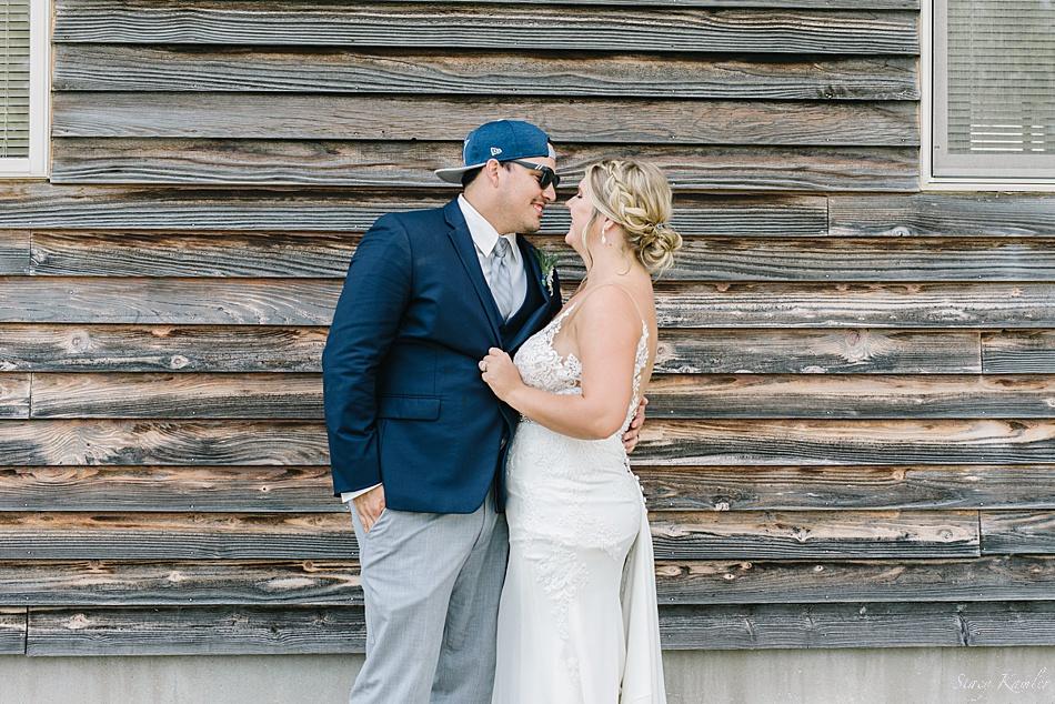 Bride and Groom, wearing Dallas Cowboys hats