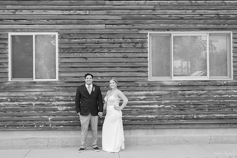 Bride and Groom in front of old wooden shed