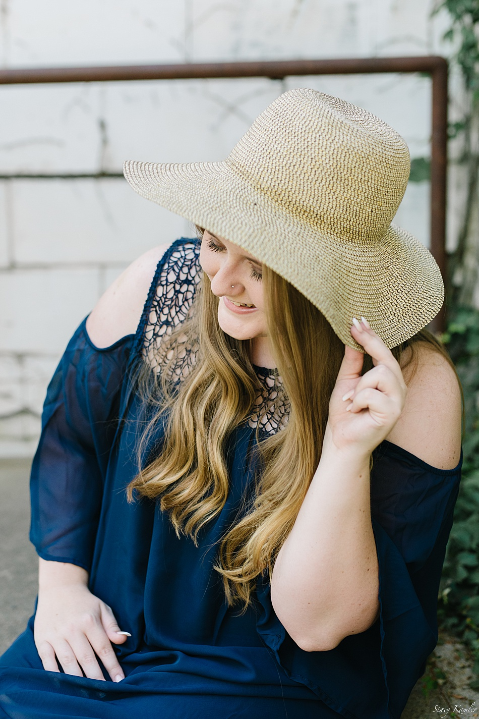 Senior girl in straw hat, downtown