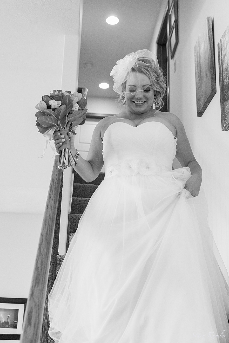 Bride walking down the stairs to her house