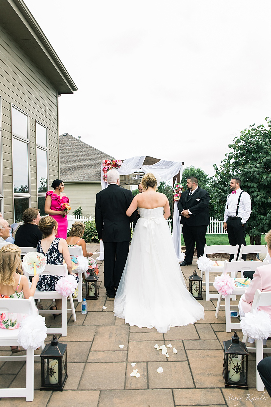 Walking down the isle in a backyard ceremony